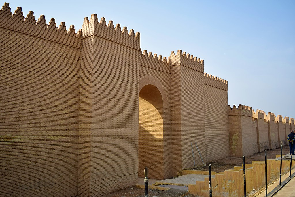 Image Illustrating the archaeological site of Babylon in Iraq. A reconstructed Neo-Babylonian external wall and gate appears