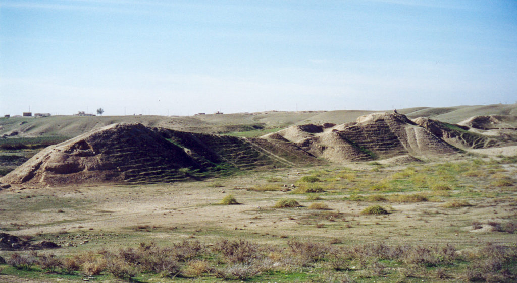 image illustrating the archaeological ruins of ashur in iraq. indistinct remains of mudbrick work appear in the image