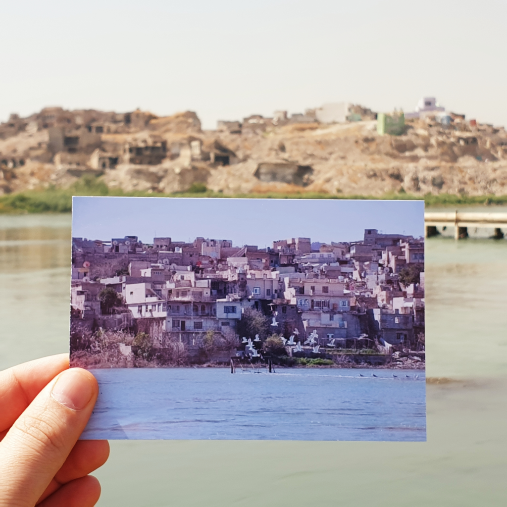 Image showing old postcard of old mosul in the foreground with ruins of destroyed old mosul in the background