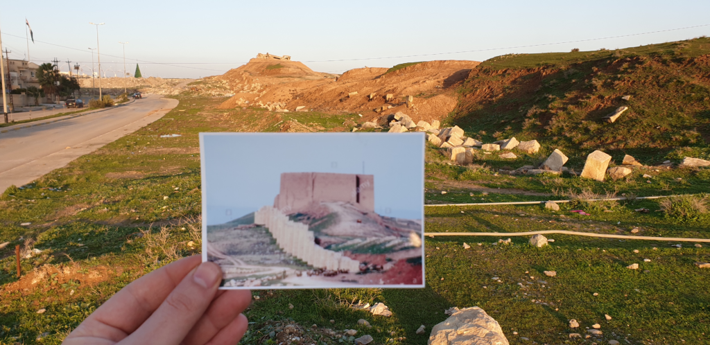 image showing postcard of ancient walls of nineveh in mosul before destruction by Daesh and the same ruins in the background after destruction